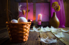 Vintage Easter basket eggs feathers Stock Images