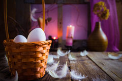 Vintage Easter basket eggs feathers royalty free stock image
