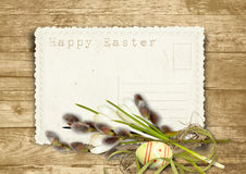 Vintage Easter card  with pussy-willow on a wooden background Stock Photography