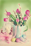 Vintage easter decoration with basket and tulips Stock Photos