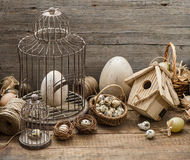 Vintage easter decoration with eggs and birdcage. Vintage easter decoration with eggs, birdhouse and birdcage. nostalgic still life home interior. wooden Stock Images