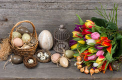 Vintage easter decoration with eggs and flowers Royalty Free Stock Photo