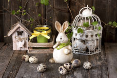 Vintage easter decoration with eggs and rabbit Stock Photos