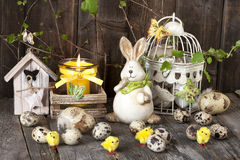 Vintage easter decoration with eggs and rabbit . Royalty Free Stock Images