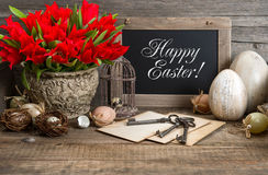 Vintage easter decoration, eggs, red tulip Stock Photos