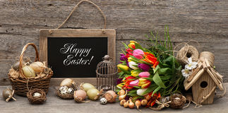 Vintage easter decoration, eggs and tulip Royalty Free Stock Image