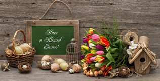 Vintage easter decoration with eggs and tulip flowers Stock Images
