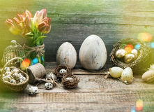 Vintage easter decoration with golden eggs and red tulip flowers Royalty Free Stock Photos