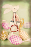 Vintage easter decoration with wooden bunny Stock Image