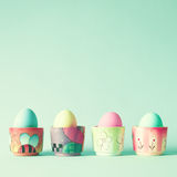 Vintage easter eggs in ceramic jars Royalty Free Stock Image