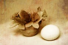 Vintage easter postcard. With flowers and egg, grunge style, rough texture added Stock Images