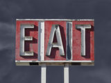Vintage Eat Sign with Dark Thunderstorm Sky Stock Photo