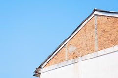 Vintage eaves brick wall in blue sky background Royalty Free Stock Photos