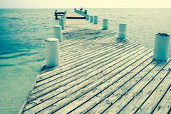 Vintage effect image old jetty. Royalty Free Stock Images