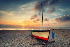 Vintage effect sailing boat at sunset Stock Photo