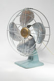 Vintage Electric Fan. 1940s vintage electric fan with metal blades with white background Royalty Free Stock Image