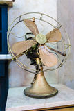 Vintage electric fan. Old vintage brass electric fan Stock Photos