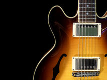 Vintage Electric Guitar. Close-up of vintage electric jazz guitar on black background Royalty Free Stock Photography