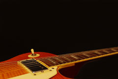 Vintage electric guitar closeup on black background, with plenty of copy space. Selective focus. Royalty Free Stock Photo