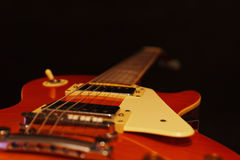 Vintage electric guitar closeup on black background. Selective focus. Royalty Free Stock Image