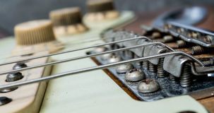 Vintage electric guitar strings and bridge. Detail of vintage electric guitar strings and bridge. Selective focus Royalty Free Stock Photo