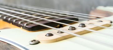 Vintage electric guitar strings and pickup. Royalty Free Stock Photos
