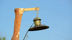 Vintage electric lamp on wooden pillar (pylon) on blue sky, vintage environment, stock footage