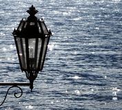 Vintage electric public lamp. Electric lamp on Lake Como Stock Images