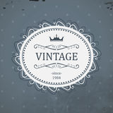 Vintage eliptical label with royal crown and grunge background. Stock Image