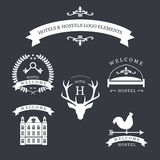 Vintage emblem with deer, kyes, weather vane, bed and old building for your hotel and hostel logo. Royalty Free Stock Photos