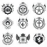 Vintage emblems, vector heraldic designs. Coat of Arms collectio. N, vector set Royalty Free Stock Photo