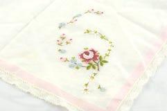 Vintage Embroidered Handkerchief. Pretty vintage handkerchief with embroidered pink flowers Royalty Free Stock Photo