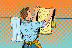 Vintage employee hangs up to dry clothes Stock Photos
