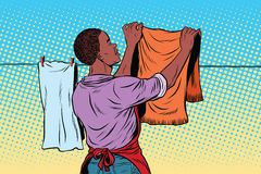 Vintage employee hangs up to dry clothes Stock Image