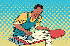 Vintage employee ironed clothes Stock Image