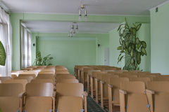 Vintage empty classroom with wooden chairs Royalty Free Stock Images
