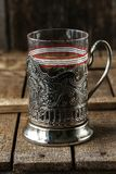 Vintage empty glass for tea with cup holder stock photography