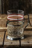 Vintage empty glass for tea with cup holder. royalty free stock photo