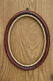 Vintage empty oval picture art frame on oak plank Royalty Free Stock Images