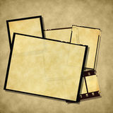 Vintage empty photo frames. Old blank photo frames and film strip on grungy background Royalty Free Stock Photo