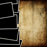 Vintage empty photo-frames on wood. Vintage empty photo-frames on wood texture Royalty Free Stock Photo