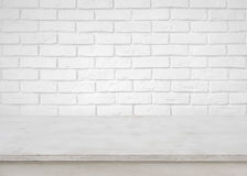 Vintage empty wooden table on defocused white brick wall background stock photos