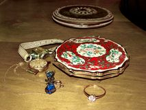 Vintage enamelled puff box, female watches and jewelry. Close up. Nostalgia. Vintage. Memories. Family jewelry. stock photography