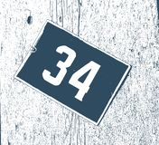 Vintage enamelled sign street number 34, Room number, Hotel number plate. This photo is perfect for backgrounds or whatever you choose vector illustration