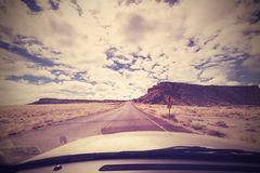 Vintage endless road, photo taken from front seat of a car, USA. Royalty Free Stock Image