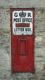 Vintage English Post Office Box. A vintage English Post Office Box integrated into a wall Royalty Free Stock Images