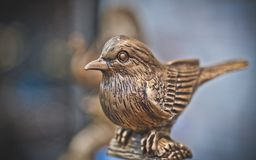 Vintage Engraved Bronze Metal Bird stock images