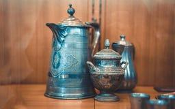 Vintage Engraved Metal Tea Pot stock image