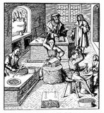 Vintage engraving, medieval coinage workshop. Vintage engraving depicting the work of making coins in a Middle Ages workshop Stock Photo