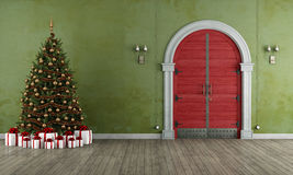 Vintage entrance with christmas tree Royalty Free Stock Image
